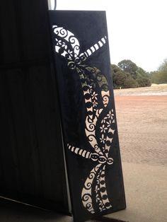Corten steel garden art panel, designed and handcrafted by Inge Giebeler using a handheld plasma cutter