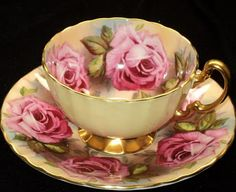 This beautiful cup is an Aynsley.   It was called Surreal Roses on the site I found it on.  It looks like a painting!