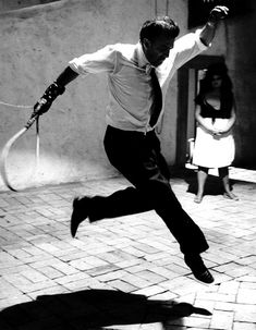 seen by ° tazio secchiaroli ° fellini jumping on the set of '8 1/2' ° 1963