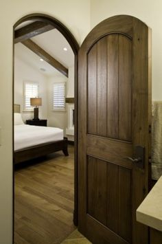 Loving the natural wood look better than the painted interior doors... i think