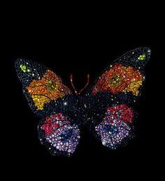 JAR Butterfly Brooch, 1994 Sapphires, fire opals, rubies, amethyst, garnets, diamonds, silver and gold.