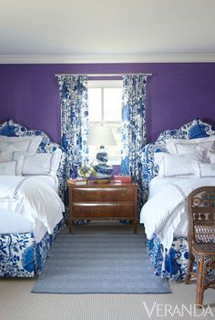 Blue and white accent the purple walls of this guest room.