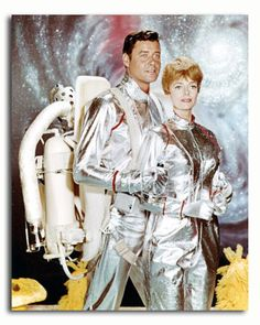 """Lost in Space - One of my favorite shows as a kid (and yes, Don West aka Mark Goddard was a dream boat AND was from the town next to mine in Mass.)  I remember the first episodes of this show were in black and white and the whole tenor or of the show was very """"tense"""" -Cold War, Russion spies (Dr. Smith was one of those spies), space race.  Once the show was colorized, it got a wee bit campy and if Dr. Smith went through a total transformation.  His shrieking used to drive my mom CRAZY!"""