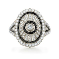 Ares onyx and diamond ring from the Kwiat Vintage Collection in 18K white gold.  A sophisticated array of brilliant diamonds blends with lustrous black onyx to create an artful design.