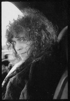 Marc Bolan. I noticed that all the men I love have the same distinct look. Jimmy Page, George Harrison, Jim Morrison, Robert Plant,  Marc here^....
