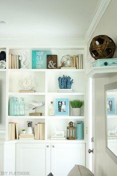 styled family room bookshelves   shelving and room