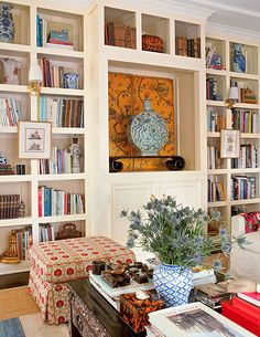 Exotically patterned fabrics from Pierre Frey on armchairs and ottomans and a vintage bone-inlay coffee table set a lively mood in this West Hollywood home. Chinoiserie, Bookcase Styling, Built In Bookcase, Bookcases, Bookshelf Ideas, Interior Exterior, Interior Architecture, Interior Design, Interior Decorating