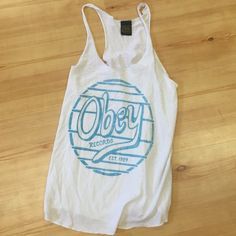 Obey white tank White Obey tank top is perfect for the summer, and has a real design on the front. Only have won a handful of times! Obey Tops Tank Tops