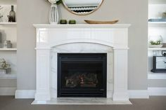 hamptons-style-living-room-with-marble-fireplace-and-built-in-shelving Hamptons Style Bedrooms, Hamptons Style Homes, Fireplace Seating, Fireplace Cover, Slate Fireplace, Limestone Fireplace, Fireplace Mirror, Marble Fireplaces, Fireplace Remodel