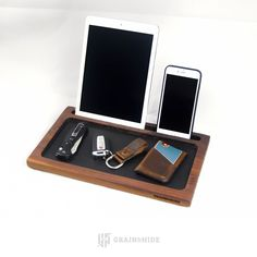 Slot for phones and tablets fits most devices, including devices with thin cases. Made of solid walnut hardwood and Horween black Latigo leather. Felt feet prevent furniture from being scratched. Dime