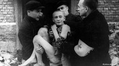 Historic photo of a concentration camp victim at the liberation of Auschwitz in 1945