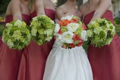 love the coordination of color. Like how bridesmaid bouquets are more green and brides has pop of ivory and coral. This is pretty much what I want.