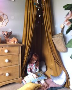 My daughter dreaming of a fairy wonderland in her vintage style whimsical reading area / book nook / children's room / girls bedroom / numero 74 mustard canopy