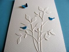 handmade greeting card ... Creamy Ivory Leafy Branches with with blue birds and a butterfly ... die cuts ... clean and graphic one layer card from aboundingtreasures on Etsy ...