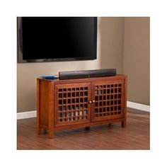This practical corner media cabinet is transformed into a polished accent furnishing with the grid-window doors and shiny pewter pulls. Accommodate your CD and DVD collection and or game consoles of different sizes, by easily arranging the height of the two adjustable shelves. | eBay!