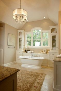stand alone tub with surrounding cabinets and window...love that it is not just a lonely tub against a plain wall!