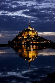 Sunset at Mont Saint Michel, France...I was lucky enough to get to stay overnight in the guest quarters of the cathedral. All you heard was monks chanting and the cry of the seagulls. Unworldly.