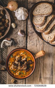 Goulash soup with croutons from baked bread