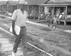 Reverend Jim Nance, canvassing, registering voters outside of Hattiesburg, MS during Freedom Summer in 1964. Photo by Herbert Randall. USM McCain Library and Archive. In the summer of 1964, COFO workers started wearing straw hats to distinguish them from SNCC and other volunteers in Mississippi during Freedom Summer.