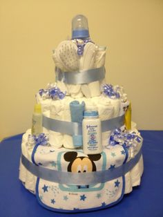 Mickey Mouse diaper cake  Just what every expecting mom needs! More Diapers. LOL