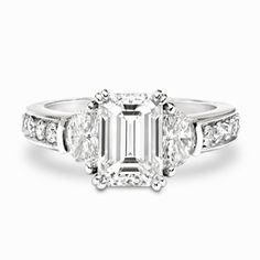 Emerald and Half-Moon Diamond Ring  With a solid 18 karat white gold construction, a 2.47 carat F-VS1 emerald cut diamond is clasped by four double prongs in a successful attempt to attract [...]
