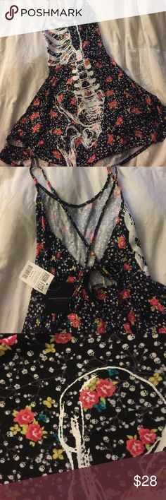 NWT Iron Fist Ditzy Skull Dress BNWT Iron Fist Ditsy Skull dress. Black dress with flowers and Skull print throughout. Re-poshing because I never wore it! Adjustable tie back. Super soft material! Iron Fist Dresses Mini
