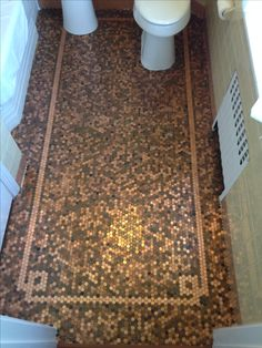 Penny tile floor with a cool design stripe.  Cool idea for a small bathroom!