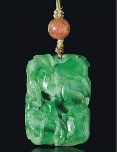 A carved jadeite 'Bat and Peach' pendant, 18th-19th century