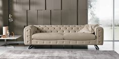 The Ingrid sofa and loveseat from Max Divani Italy. Tufted traditional cover with a sleek modern accents make for an all new look in italian furniture design. Aviale in a wide range of colors for both fabric and natural italian leather.