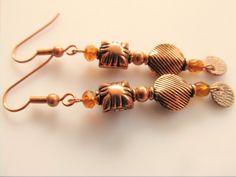 Oorbellen Copper Luca koperen kralen met kristalglas facet rondel en een tsjechisch glaskraaltje. geheel koper