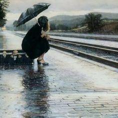 Girl sitting under her umbrella         in the rain
