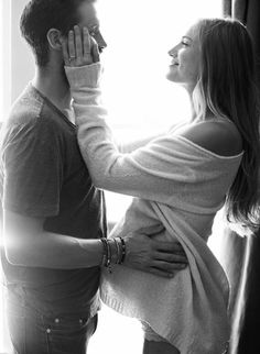 A unique way to show their love to each other, and their future child. Love the look of the light behind them.