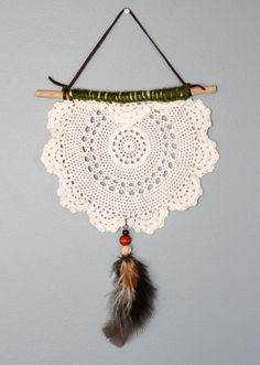 nora. an earthy toned and white vintage doily dream catcher.. $30.00, via Etsy. (and happen to love the name of it too!)