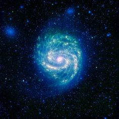 The galaxy Messier 100, or M100, shows its swirling spiral in this infrared image from NASAs Spitzer Space Telescope. The arcing spiral arms of dust and gas that harbor starforming regions glow vividly when seen in the infrared.