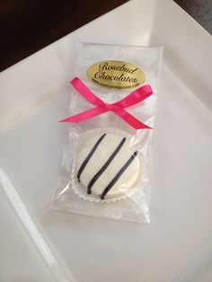 White Chocolate Dipped Oreo Cookies with black stripes... www.rosebudchocolates.com