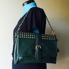Gold Studded Bag Lead and nickle safe faux leather bag that can be carried over the shoulder or used as clutch. Gifted to me but not my style. Interior has side zipper and two additional pockets (cell/keys). NO TRADES Boutique Bags Shoulder Bags