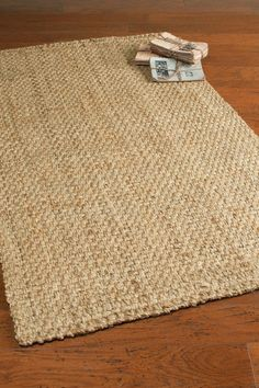 Item #68315  $450  Hand woven of 100% un-bleached, un-dyed jute, our Jute Woven Rug is crafted in a basket weave pattern, adding a casual elegance to any space. Reversible.
