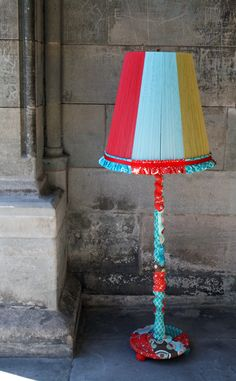 vintage lamp wrapped with assorted cotton. lampshade wrapped in matching colored yarn.