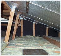 Crawlspace insulation with vapor barrier for ground.