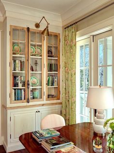 Creating A Chic, Cosy Home Library-Best Colors, Lighting and Furniture - laurel home | handsome and pretty home office or dining room or library with a cool glass fronted bookcase or china cabinet. Love the library sconce. via Structures Blog. Architecture –  Darryl Cobb – Interior design – Deborah Way