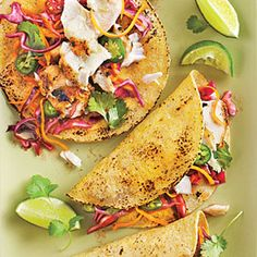 Grilled Fish Tacos with Jalapeño-Cabbage Slaw - Looks DELISH!!!