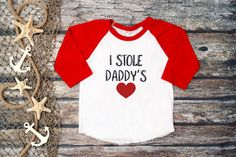 Add this trendy Valentines Day raglan tee to your little ones wardrobe and show the world who your valentine is. Our super soft I stole daddys