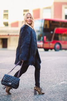 Black faux fur coat and Chanel bag