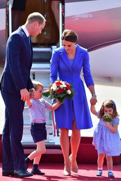 Kate Middleton Photos Photos - Prince William, Duke of Cambridge, Catherine, Duchess of Cambridge with Prince George of Cambridge and Princess Charlotte of Cambridge as they arrive at Berlin Tegel Airport during an official visit to Poland and Germany on July 19, 2017 in Berlin, Germany. - The Duke and Duchess of Cambridge Visit Germany - Day 1