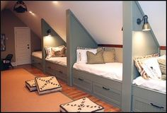 use the attic portion or awkward bonus room ceiling space of a house and provide lots of sleeping space. What a fun bunk room Attic Bedrooms, Home Bedroom, Kids Bedroom, Bunk Rooms, Bedroom Loft, Bedroom Decor, Bedroom Furniture, Upstairs Bedroom, Triplets Bedroom