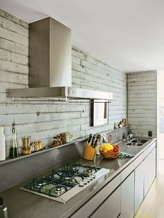 In the kitchen of a renovated São Paulo apartment, Silestone countertops were installed above custom plywood cabinets finished with automotive paint. (via Dwell) Modern Kitchen Renovation, Kitchen Interior, Kitchen Remodel, Open Plan Kitchen, Kitchen Dining, Kitchen Ideas, Dining Room, Silestone Countertops, Plywood Cabinets