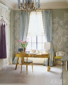 The dressing room in the Manhattan apartment of Estée Lauder creative director Aerin Lauder Zinterhofer is a tribute to her grandmother's signature style—including Estée's favorite blue-and-white color scheme and Gracie wall coverings. The chandelier is by Baguès, and the circa-1970 desk is by Gabriella Crespi.