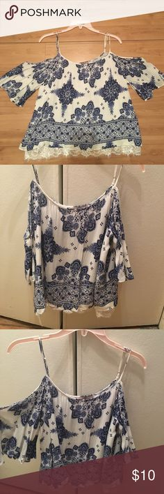 Print cold shoulder top Perfect for vacay. Blue and white print cold shoulder boho top with lace detail at bottom Forever 21 Tops Tank Tops
