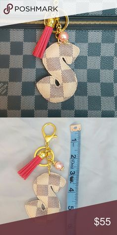 """""""S"""" charm RESERVED FOR @HAMER6  Handbag charm keychain upcycled from 100% authentic Louis Vuitton canvas.   LV canvas is used on both sides so you don't have to worry about the charm flipping over.  Check my closet for tassel and bead color options. I can also adjust the clip size if you prefer a smaller clip or just a key ring.  These are handmade with LVoe :) Louis Vuitton Accessories"""