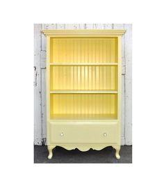 oh how I want it! But alas, it is yellow.  :( Bookcase with Drawer. $350.00, via Etsy.